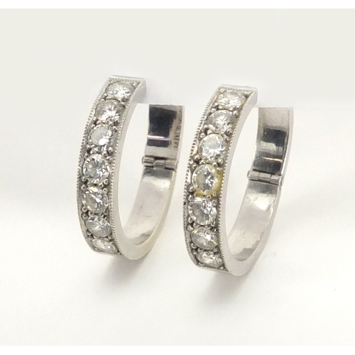 667 - Pair of unmarked white metal diamond hoop earrings, 2.4cm in diameter, approximate weight 8.3g...