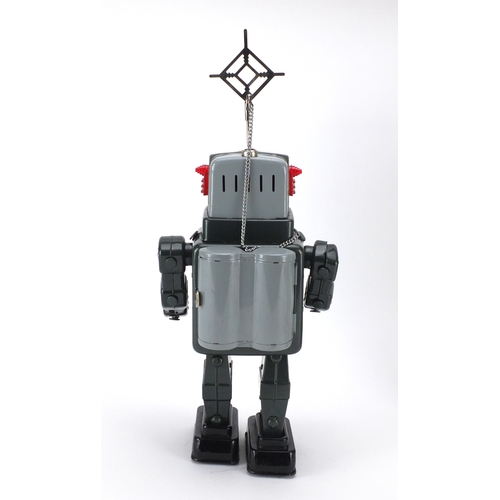 132 - Japanese tin plate television spaceman robot, Battery operated with box, 27cm high...