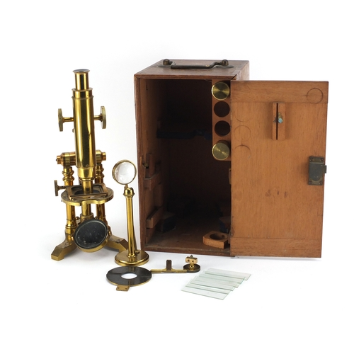 27 - 19th century brass microscope by Ross of London, numbered 5219 with lenses and fitted mahogany case...