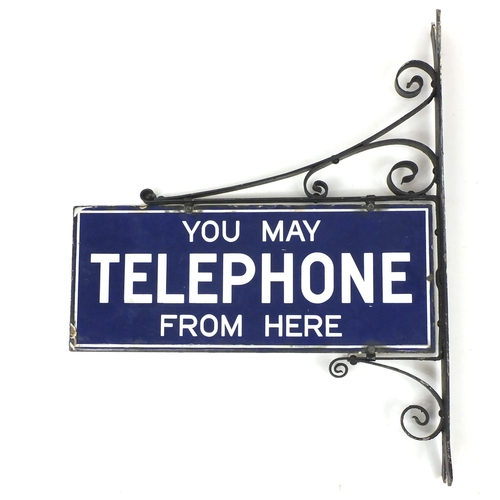 112 - Vintage You May Telephone From Here enamel advertising sign, with hanger, overall 72.5cm x 58cm...