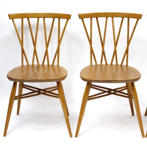 2005 - Ercol light elm drop leaf dining table and four candlestick dining chairs, each chair 80cm high...