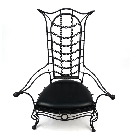 2053 - Gothic style cast iron open arm chair with faux leather seat, 133cm high...