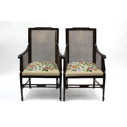 2021 - Mahogany framed bergère three piece salon suite, with needlepoint stuff over seats, the settee 102cm...