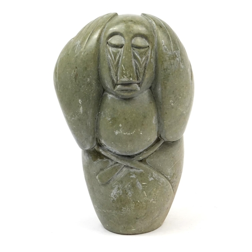 2058 - Modernist stone carving of a figure holding his hands on his head, 47cm high...