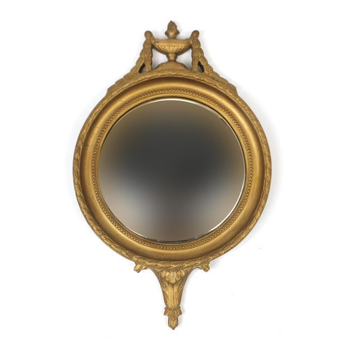 2019 - Gilt circular convex mirror with urn decoration, 64cm high...