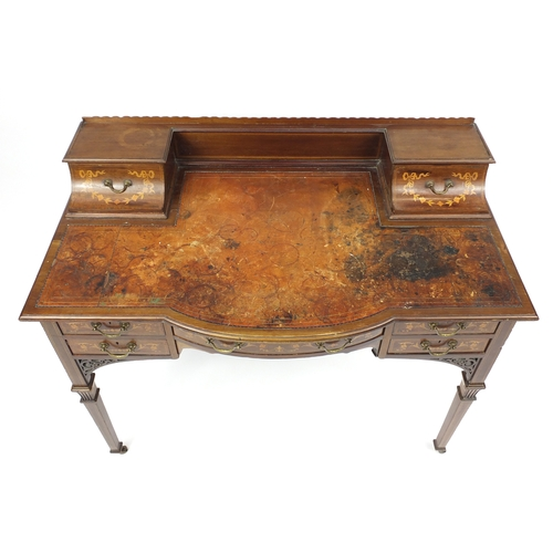 2011 - Victorian inlaid mahogany writing desk with tooled leather insert and an arrangement of seven drawer...