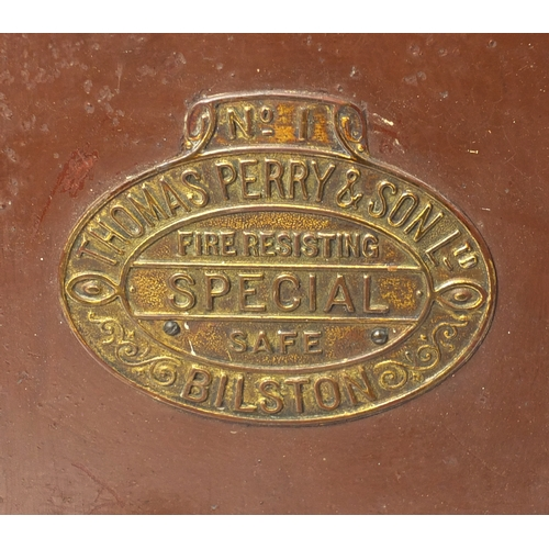 2042 - Late Victorian safe by Thomas Perry & Son Ltd, opening to reveal a drawer to the interior, with keys...