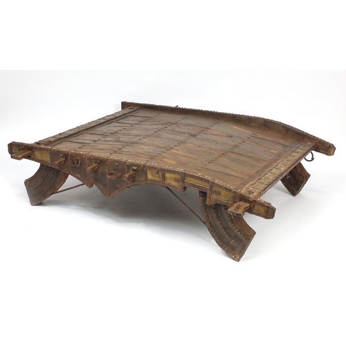 2056 - Indonesian hardwood Howdah table with metal mounts, 42cm H x 150cm W x 140cm D...