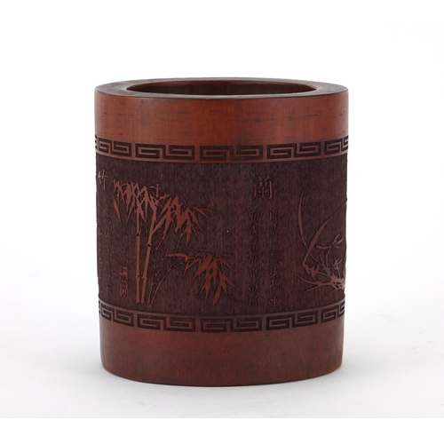 2043 - Chinese bamboo brush pot, carved with trees and calligraphy, 12cm high...
