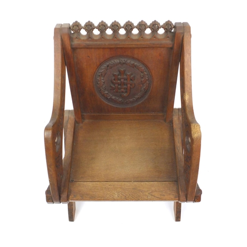 2009 - 19th century Gothic style carved oak Glastonbury chair, 84cm high...