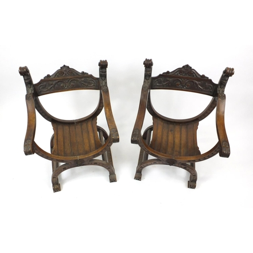 2005 - Pair of late 19th century renaissance style walnut throne chairs, carved with heads and foliage, eac...
