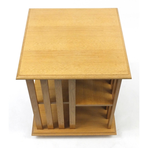 2003 - Square light oak revolving bookcase, 74cm H x 60cm W x 60cm D...