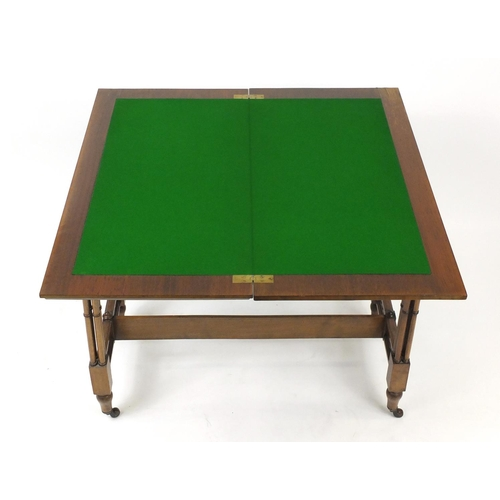 2002 - Fold over card table on quadruple simulated bamboo legs, carved with gothic arches, 76cm H x 92cm W ...