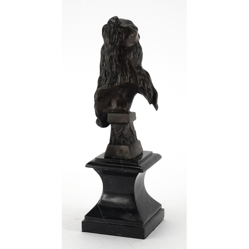 2045 - Patinated bronze bust of an Art Nouveau female, raised on a black marble base, 29cm high...