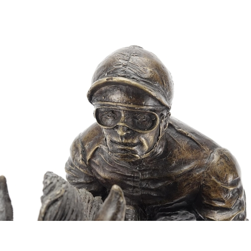 2031 - Patinated bronze bust of a jockey on horseback, raised on a rectangular black marble base, incised G...