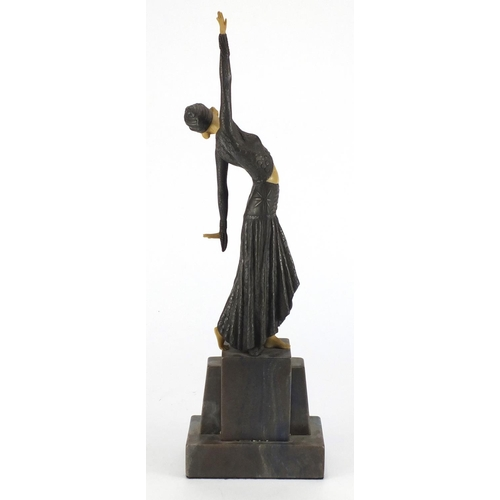 2029 - Art Deco style figurine of a dancer in the manner of Chiparus, raised on a marble base, 42cm high...