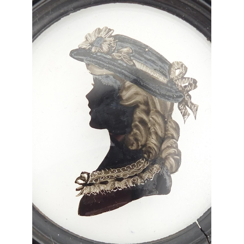 35 - 19th century reverse glass hand painted silhouette of a female, housed in an ebonised frame, the sil...