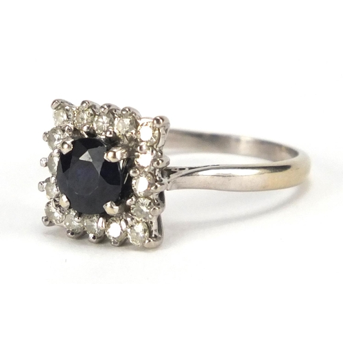 664 - 18ct white gold sapphire and diamond ring, size O, approximate weight 3.8g...