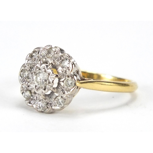 670 - 18ct gold and platinum diamond flower head ring, size O, approximate weight 3.8g...