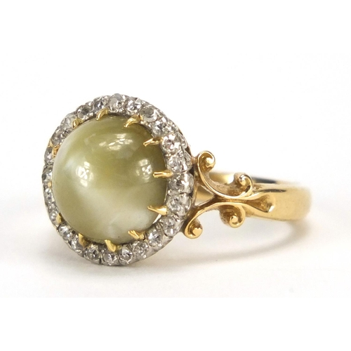 656 - 18ct gold green cabochon tiger's eye and diamond ring with scroll shoulders, the band stamped R.P po...