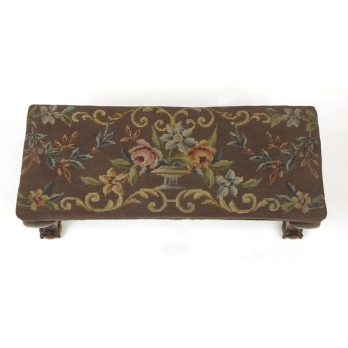 28 - Mahogany foot stool with ball and claw feet and needlepoint upholstery, 30cm H x 71cm W x 27cm D...