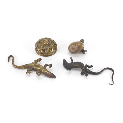 15 - Early 20th century Austrian Patinated bronze lizard, together with two brass paperweights and a bras...