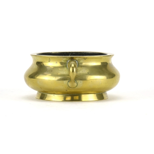 325 - Chinese bronze incense burner with twin handles, six figure character marks to the base, 6.5cm high ...