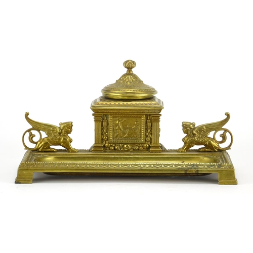 22 - 19th century gilt brass desk inkwell mounted with griffinns, cast with stylised foliate motifs, 22cm...