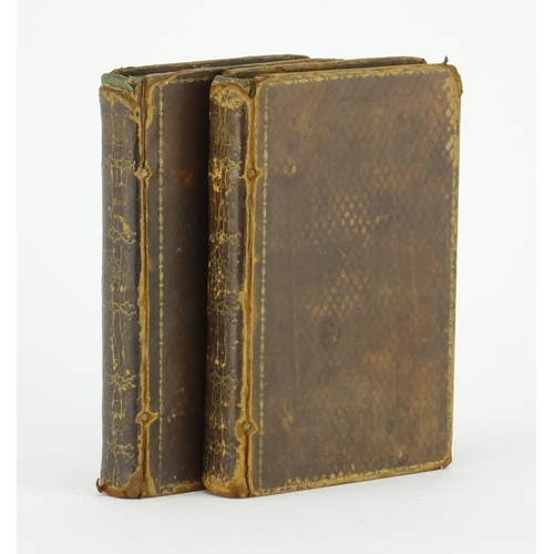 136 - Citizen of the World by Doctor Goldsmith, two early 19th century tooled leather bound hardback books...