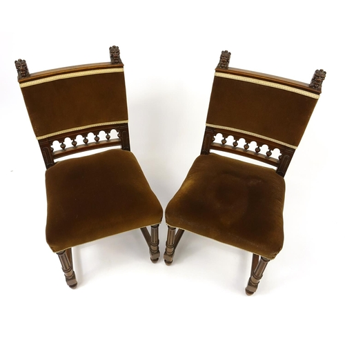 26 - Pair of walnut framed occasional chairs, with reeded legs and carved with lion heads, 95cm high...