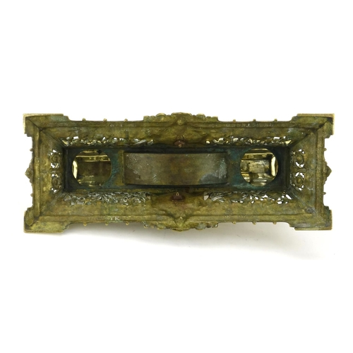 21 - Victorian brass desk stand with hinged lid, lion mask and pierced body, registered number 1387 to th...