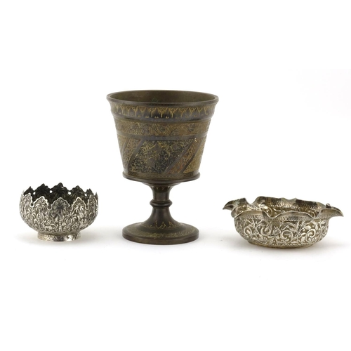 401 - Two Anglo Indian unmarked silver bowls together with an enamelled brass chalice, the largest 16cm hi...