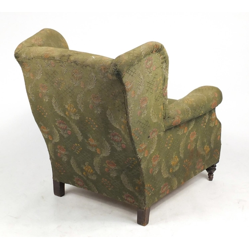 7 - Wingback armchair with green floral horse hair upholstery...