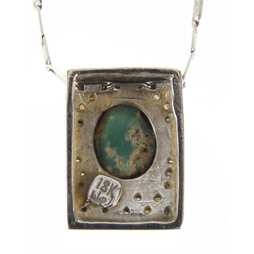653 - 18ct white gold cabochon jade and diamond pendant, on a 18ct white gold necklace, the pendant 1.7cm ...