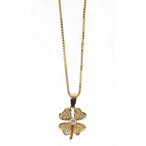 660 - Unmarked gold diamond four leaf clover pedant on an 18ct gold necklace, the pendant 2.5cm in length,...