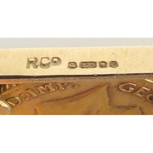 662 - George V 1911 gold half sovereign set in a 9ct gold six row gate bracelet, with love heart shaped pa...