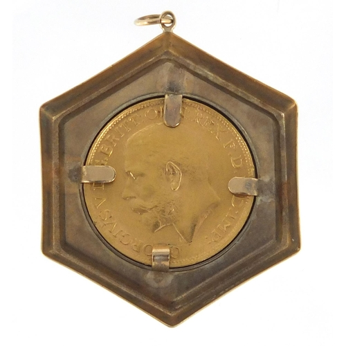 673 - George V 1919 gold sovereign set in a 9ct gold pendant mount, approximate weight 11.6g...