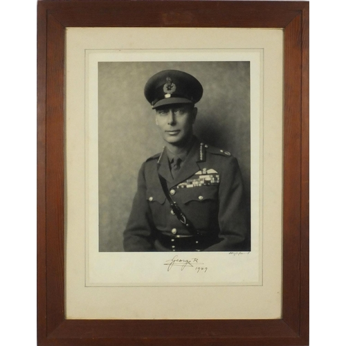 120 - Black and white photograph of King George VI in Military uniform by Hugh Cecil, signed by King Georg...