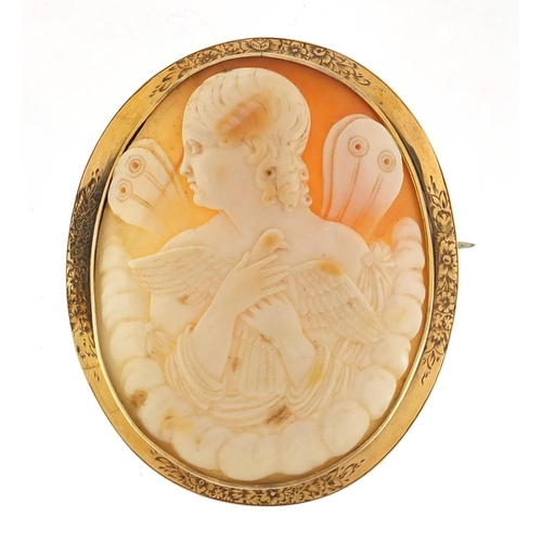 667 - Large Victorian unmarked gold cameo brooch depicting a young maiden holding a dove, 6.5cm in length,...