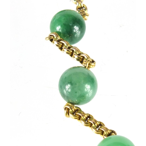 641 - 9ct gold and green jade bead necklace, 44cm in length, approximate weight 34.5g...