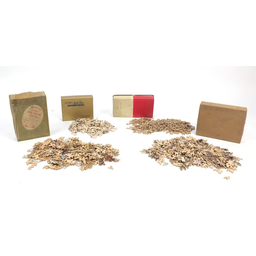 147 - Four vintage wooden jigsaw puzzles including Victory...
