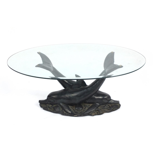 6 - Dolphin coffee table with bevelled glass top, 46cm H x 113cm W x 81cm D...