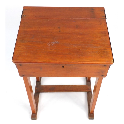 29 - Vintage stained pine school desk, with The Educational Supply stamp to the back, 82.5cm H x 61cm W x...