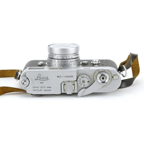 99 - Leica M2 Rangefinder Camera with Elmar lens and leather case, the camera serial number 1103653...