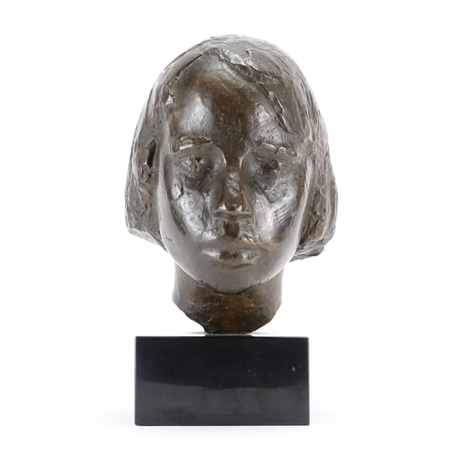 5 - Patinated bronze bust of a young female, raised on a square black slate base, overall 35cm high...