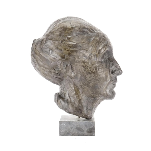 6 - Bronze half head bust of a female, raised on a square slate base, overall 32cm high...
