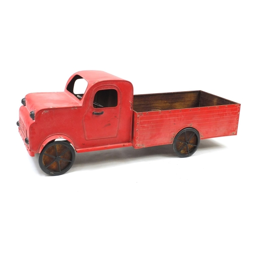 35 - Large red painted metal truck garden planter, 155cm in length...