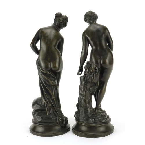 3 - Pair of patinated bronze figures of semi-clad maidens, the largest 34cm high...