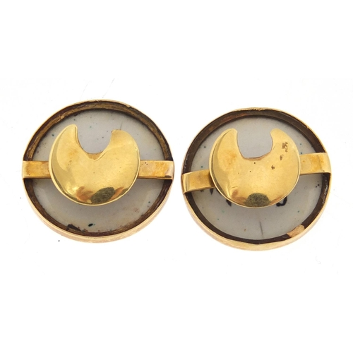 680A - Pair of unmarked gold and enamelled studs, depicting Chilton & Géneve, each 1.7cm in diameter, appro...