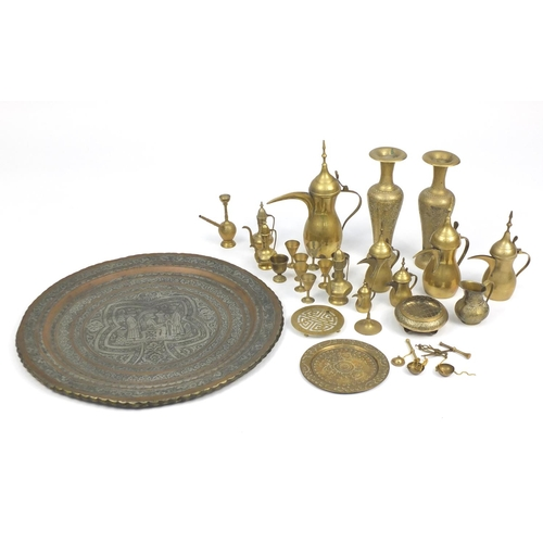 550 - Mostly Middle Eastern metalwares, including coffee pots and a pair of vases engraved with flowers an...